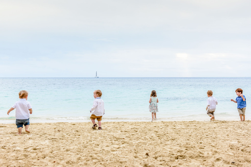 The couple's children and family friends go into the ocean at family Beach Wedding on Malolo Island, Plantation Island Resort, Fiji Wedding Photographer