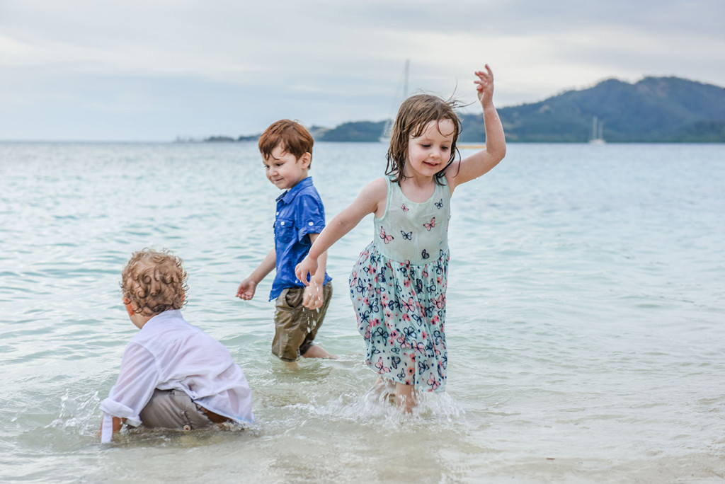 Babies splash in the water at the wedding at Malolo Island, Plantation Island Resort, Fiji Wedding Photographer