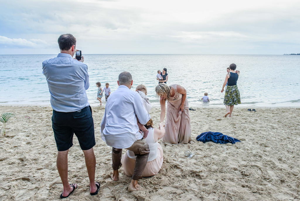 The couple and their guests get wet splashing about in the ocean at Malolo Island, Plantation Island Resort, Fiji Wedding Photographer