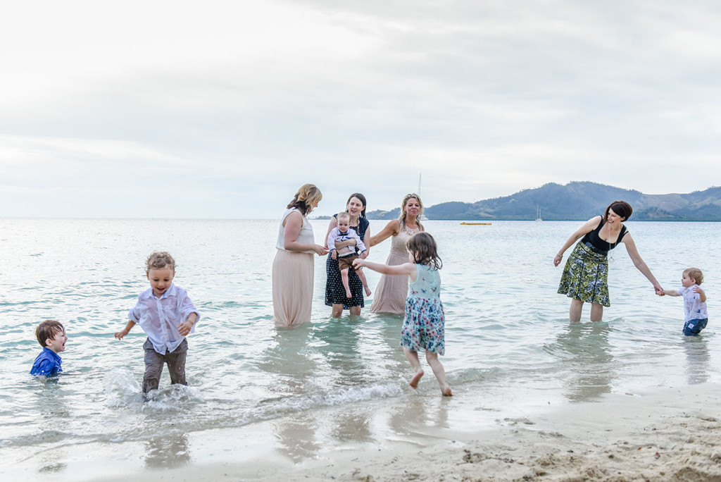Friends and babies of the couple splash about at Malolo Island, Plantation Island Resort, Fiji Wedding Photographer