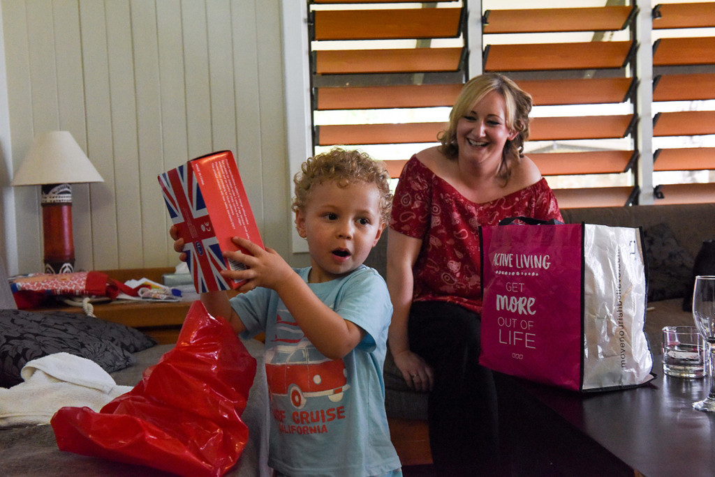 The couple's son plays with his presents before the Fiji beach wedding, Malolo Island, Plantation Island Resort, Fiji