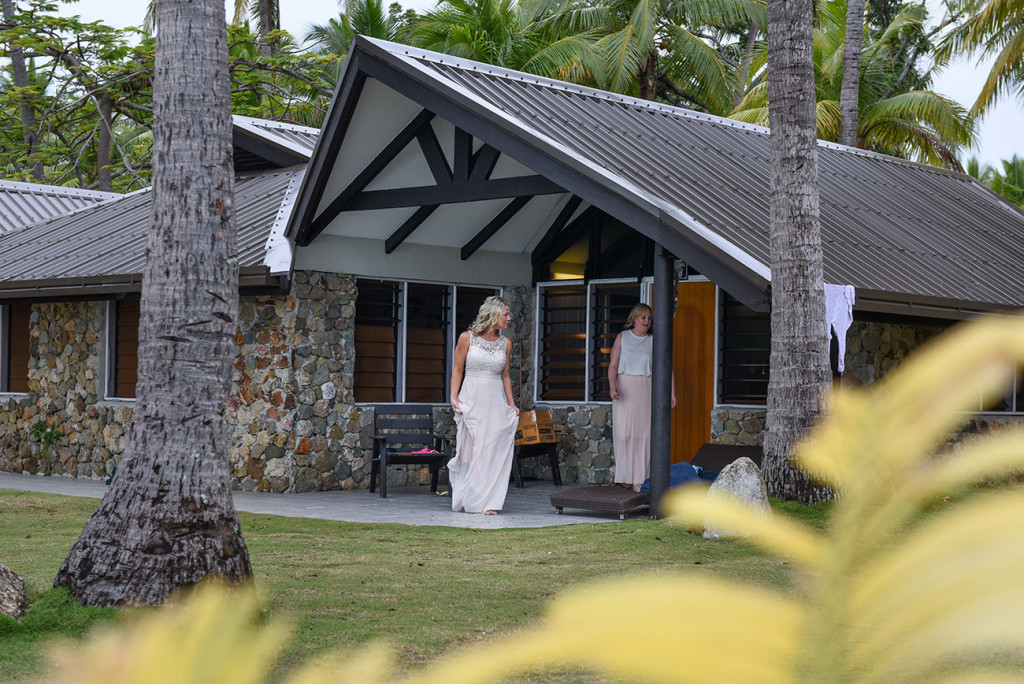 The bride emerges from her room for her amily Beach Wedding on Malolo Island, Plantation Island Resort, Fiji Wedding Photographer