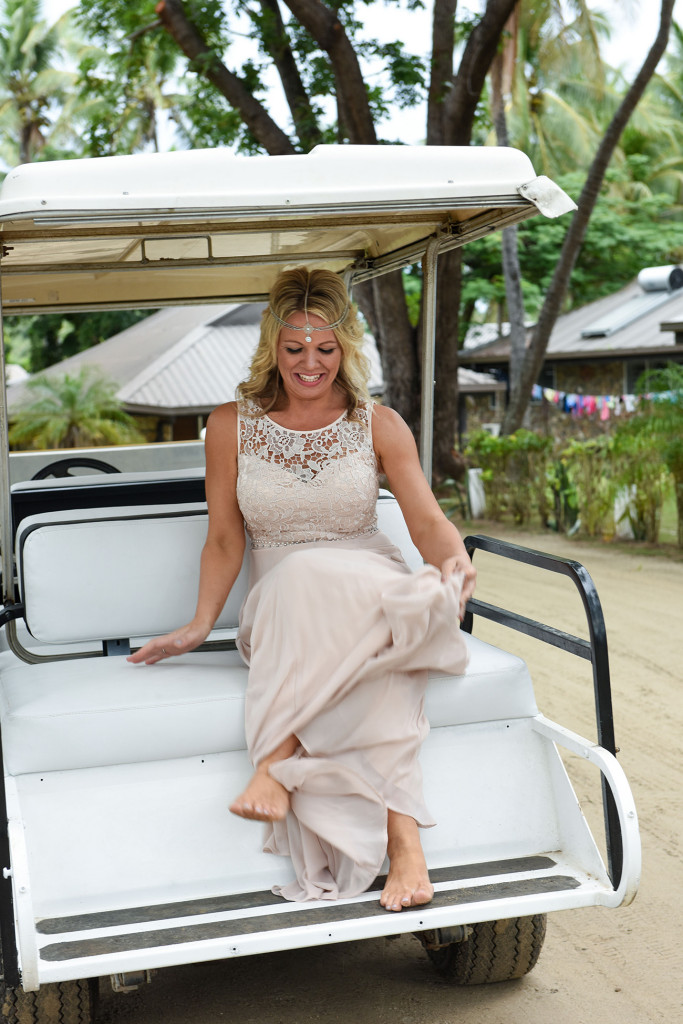 Bride on golfcart ready in her gown at the amily Beach Wedding on Malolo Island, Plantation Island Resort, Fiji Wedding Photographer