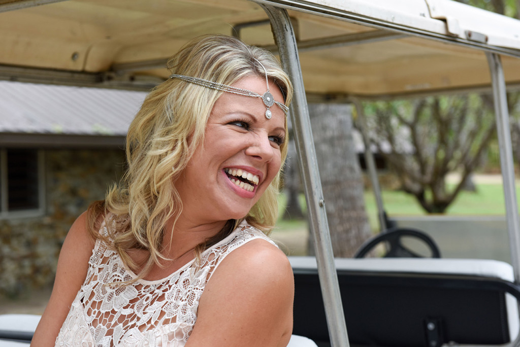 Bride smiling seated in a golfcart at her amily Beach Wedding on Malolo Island, Plantation Island Resort, Fiji Wedding Photographer