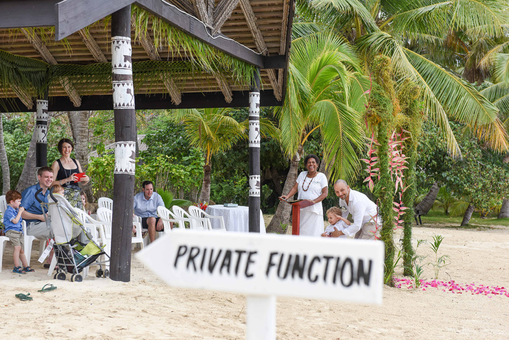 The guests at the family Beach Wedding and private function sign on Malolo Island, Plantation Island Resort, Fiji Wedding Photographer