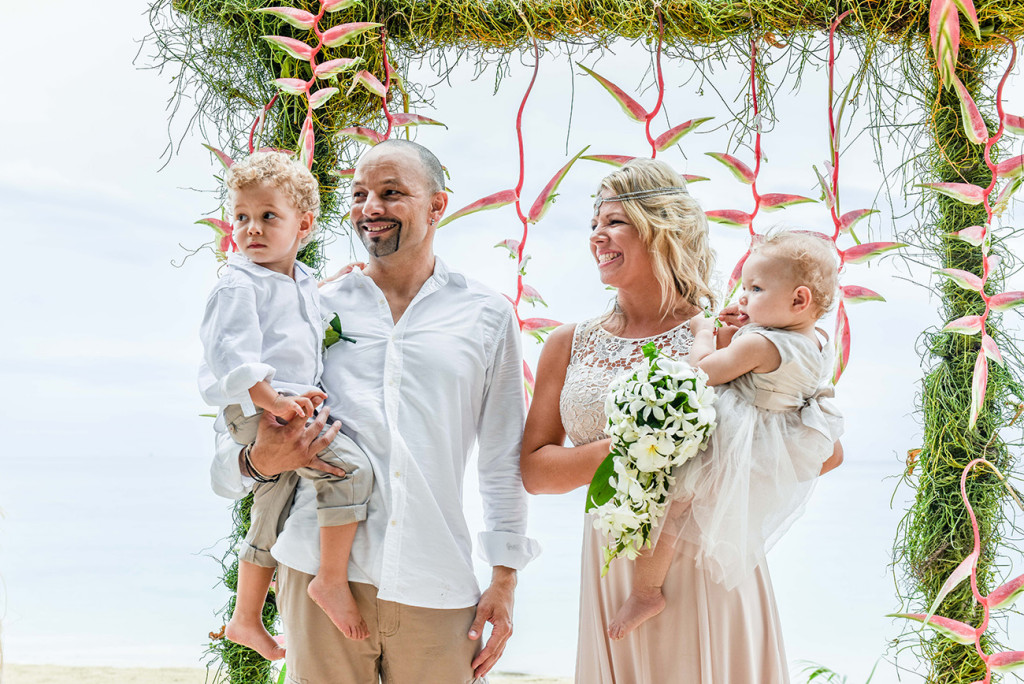 The family stands at the altar of their family Beach Wedding on Malolo Island in Fiji Wedding Photographer