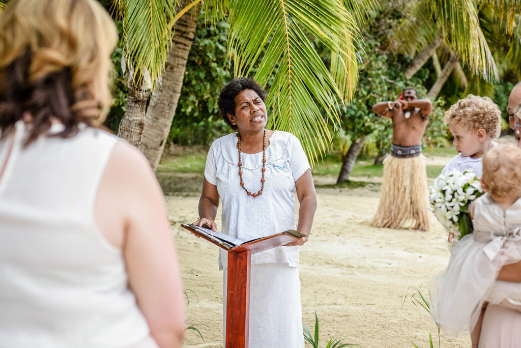 The Fijian celebrant officiates the Fiji Beach wedding ceremony