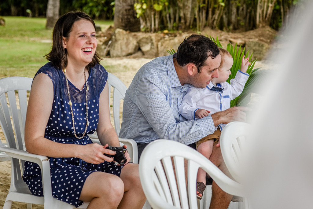 Friends watching the couple at their family Beach Wedding on Malolo Lei Lei, in Plantation Island Resort, Fiji.