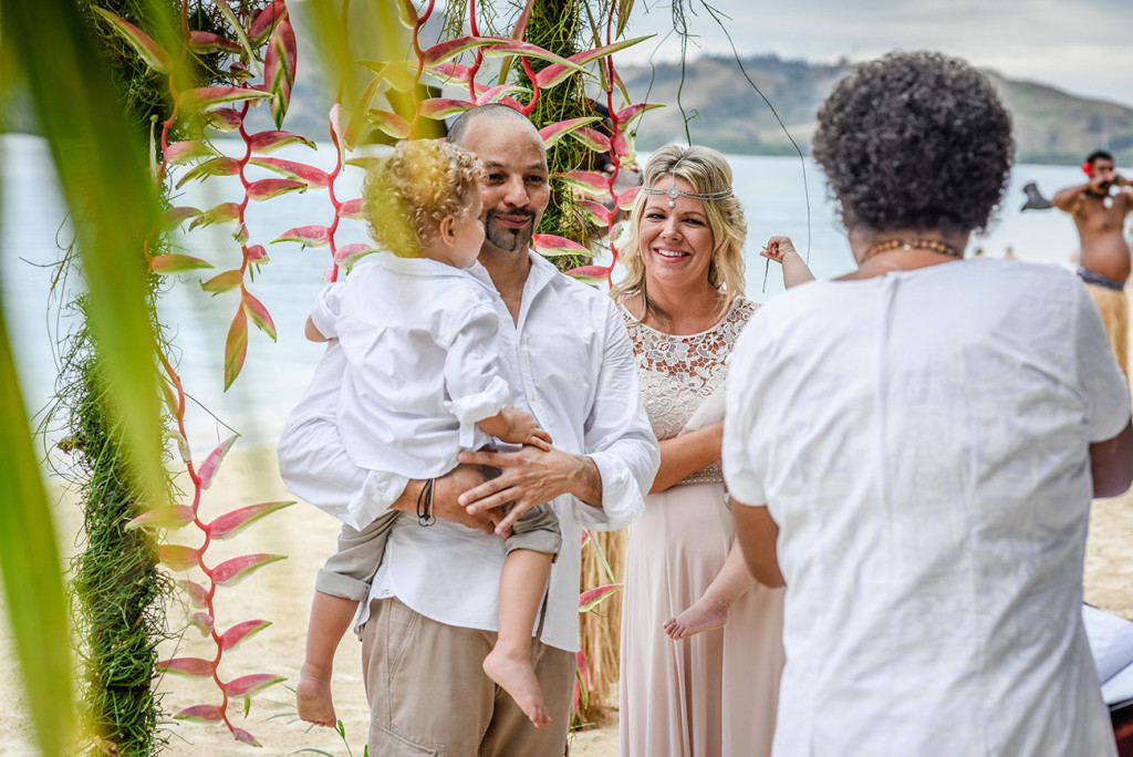 Bride and groom at the altar of their family Beach Wedding on Malolo Island, Plantation Island Resort, Fiji Wedding Photographer