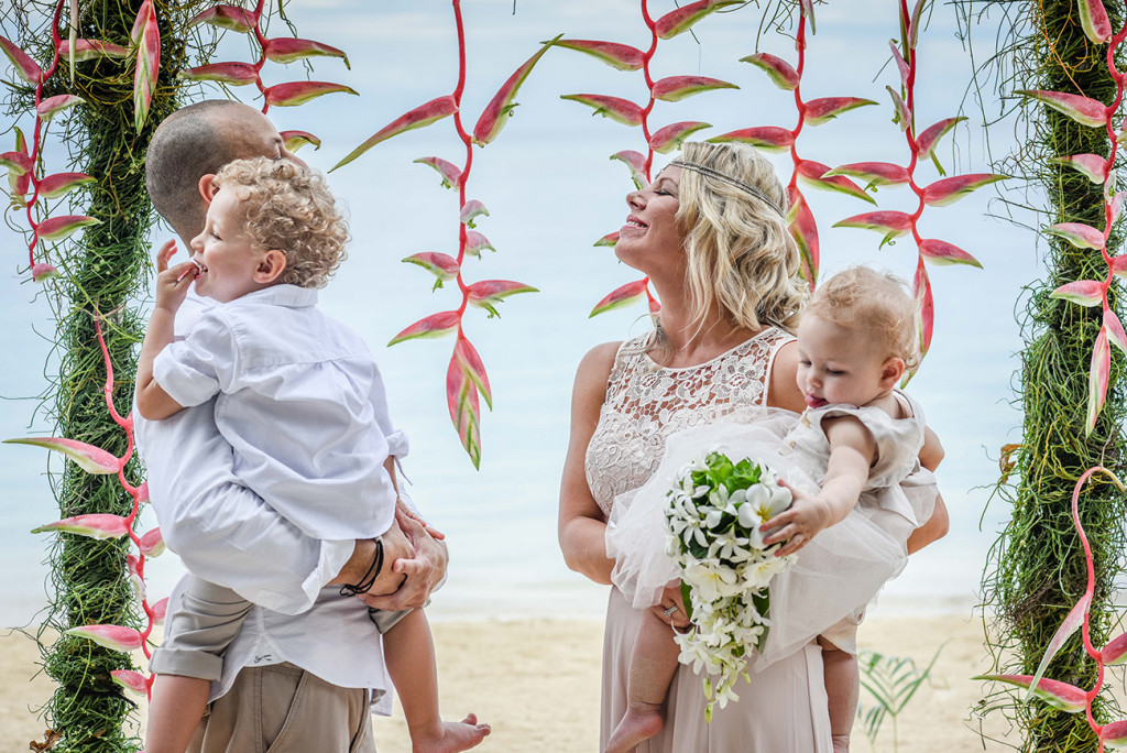 The couple laugh at the altar of their family Beach Wedding on Malolo Island, Plantation Island Resort, Fiji Wedding Photographer
