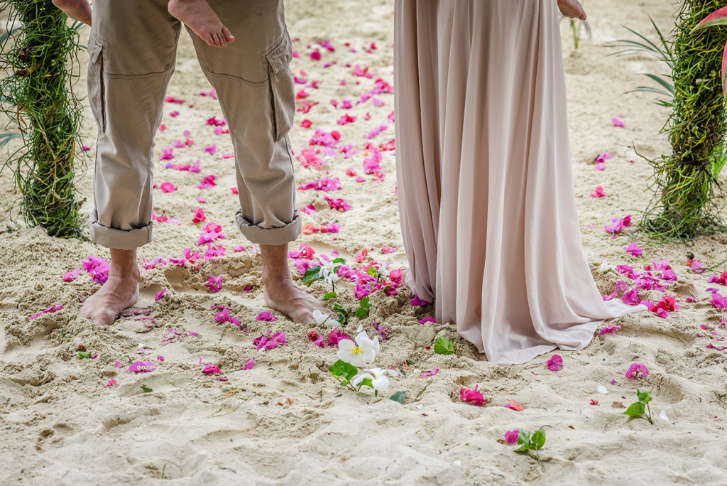 Flower petals at the feet of the couple at their family Beach Wedding on Malolo Island, Plantation Island Resort, Fiji Wedding Photographer