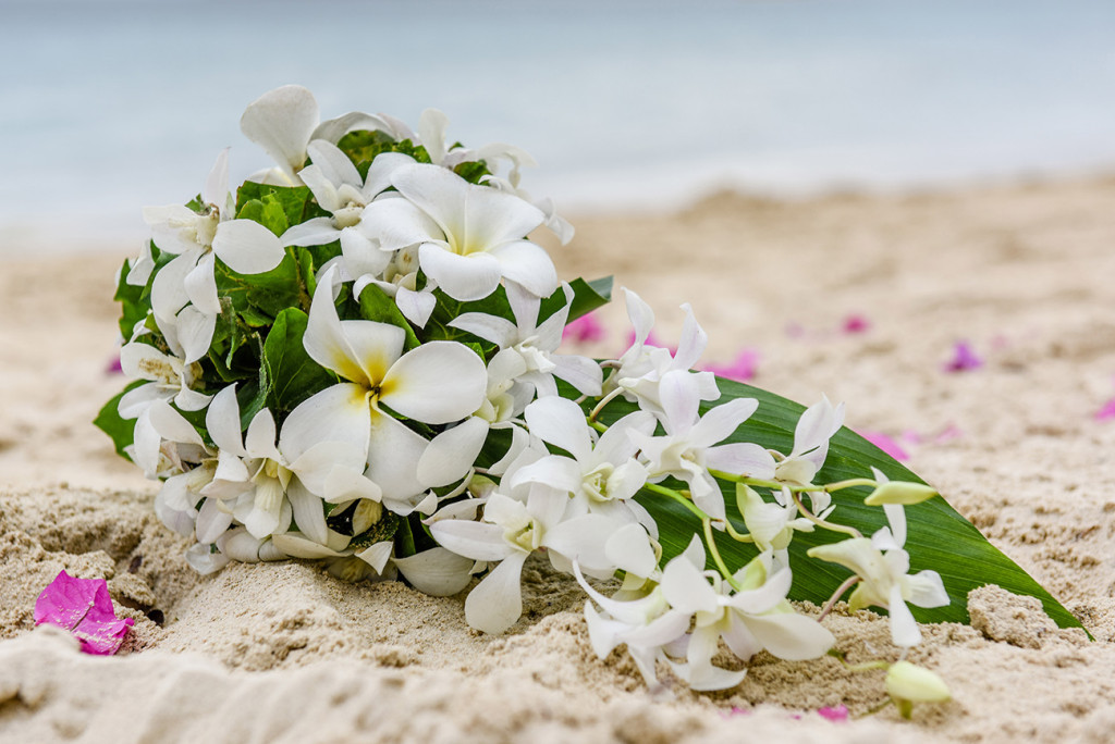 White plumeria flower bouquet on the beach at the family Beach Wedding on Malolo Island, Plantation Island Resort, Fiji Wedding Photographer