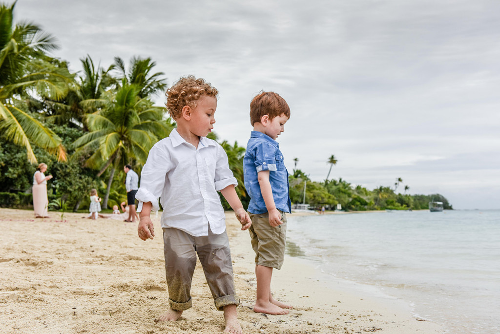 Boys play at the seashores at their parent's family Beach Wedding on Malolo Island, Plantation Island Resort, Fiji Wedding Photographer