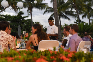 Wedding reception at the Sofitel Denerau Nadi at sunsett light with beautiful palm trees and tropical feel. By Anais Photography.