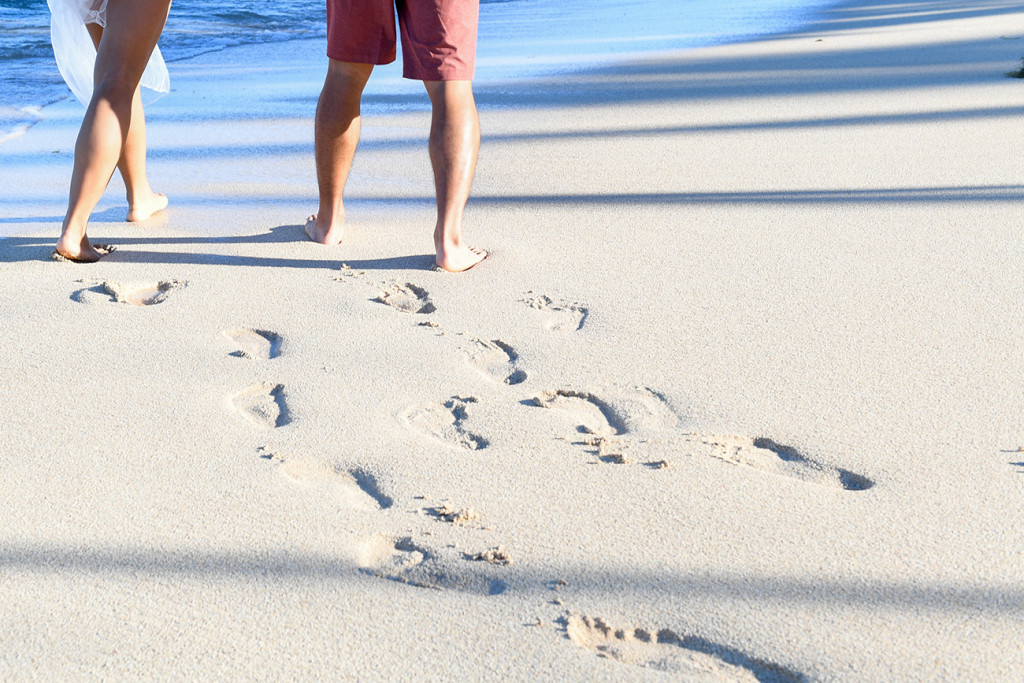 feet in the white send and foot prints at Tokoriki island resort in Fiji photographed by Anais Photography