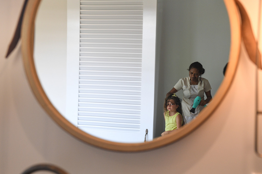 Through the mirror reflection of the ldaughter getting reading for her parent's renewal of vows at Vomo island resort in Fiji