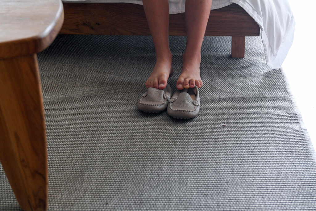 Detail of the son'ts feet and his shoes at Vomo Island resort, Fiji