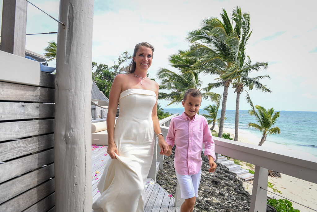Mother holding her son's hand and walking to the ceremony at Vomo Island resort, Fiji