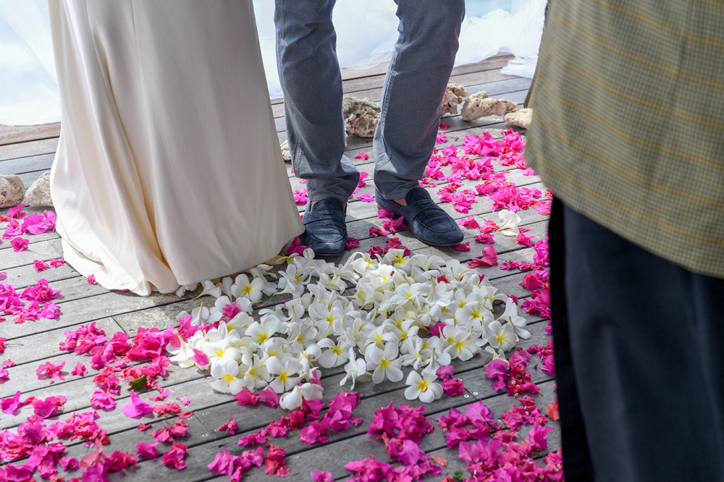Tropical Fijian flowers on the floor in the shape of a heart with the couple in the middle at their 10 years wedding anniversary at Vomo Island resort, Fiji