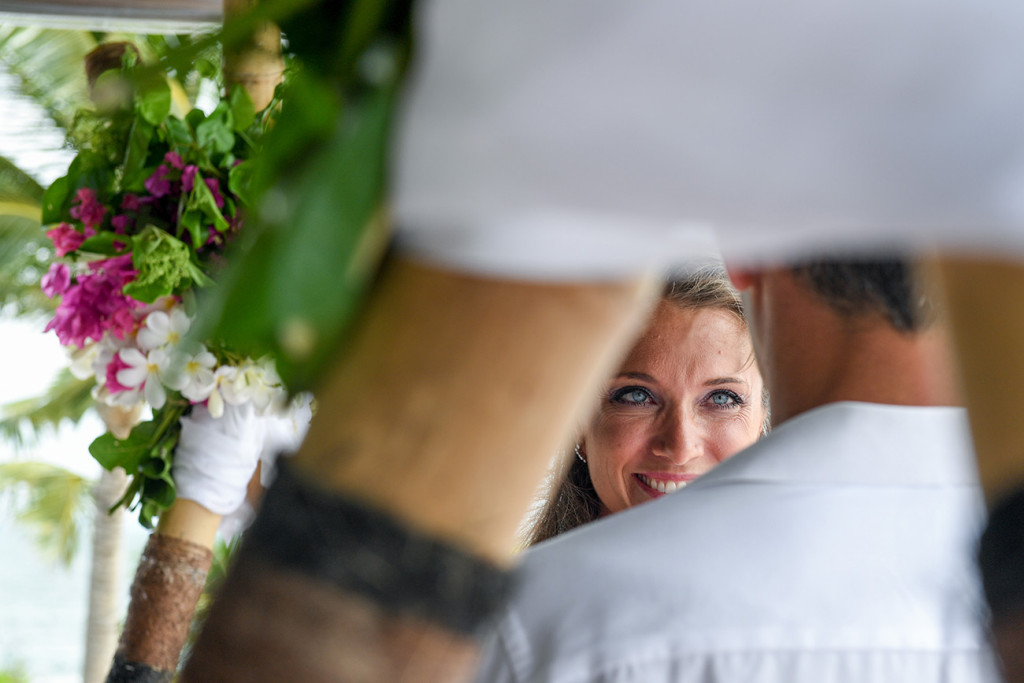 Wife is looking at her husband smiling during the ceremony at Vomo Island resort, Fiji
