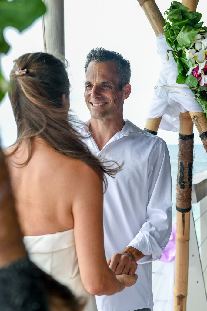 Husband looking at his wife at the ceremony at Vomo Island resort, Fiji