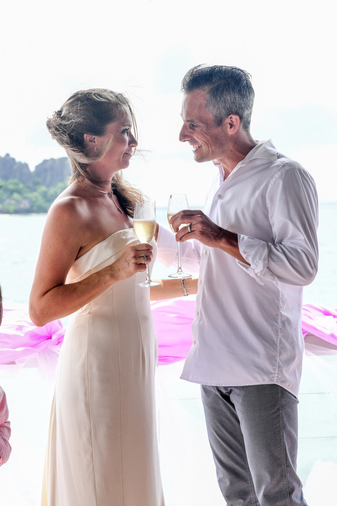 The husband and wife are cheering with champagne after the ceremony at Vomo Island resort, Fiji