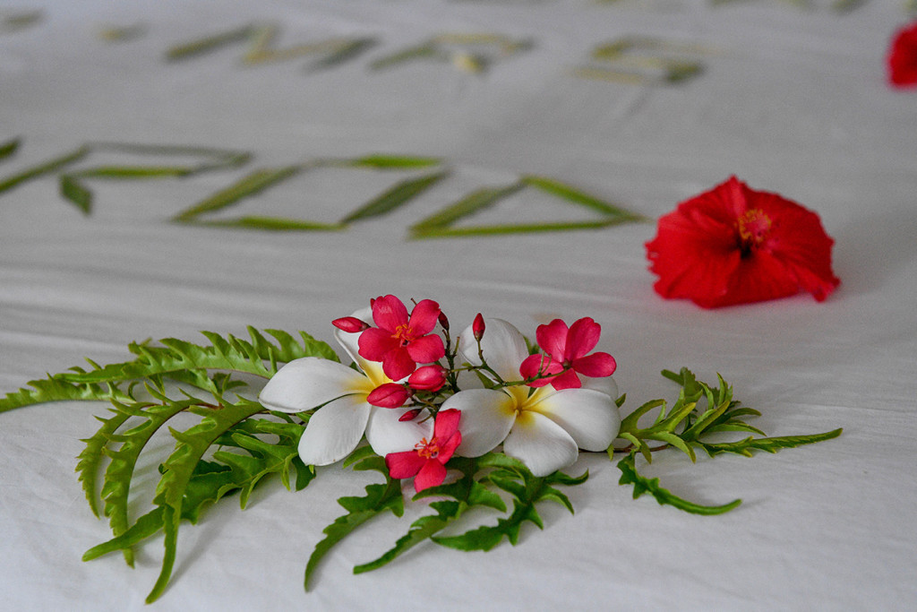 Frangipane flowers on the bed at Vomo Island resort, Fiji