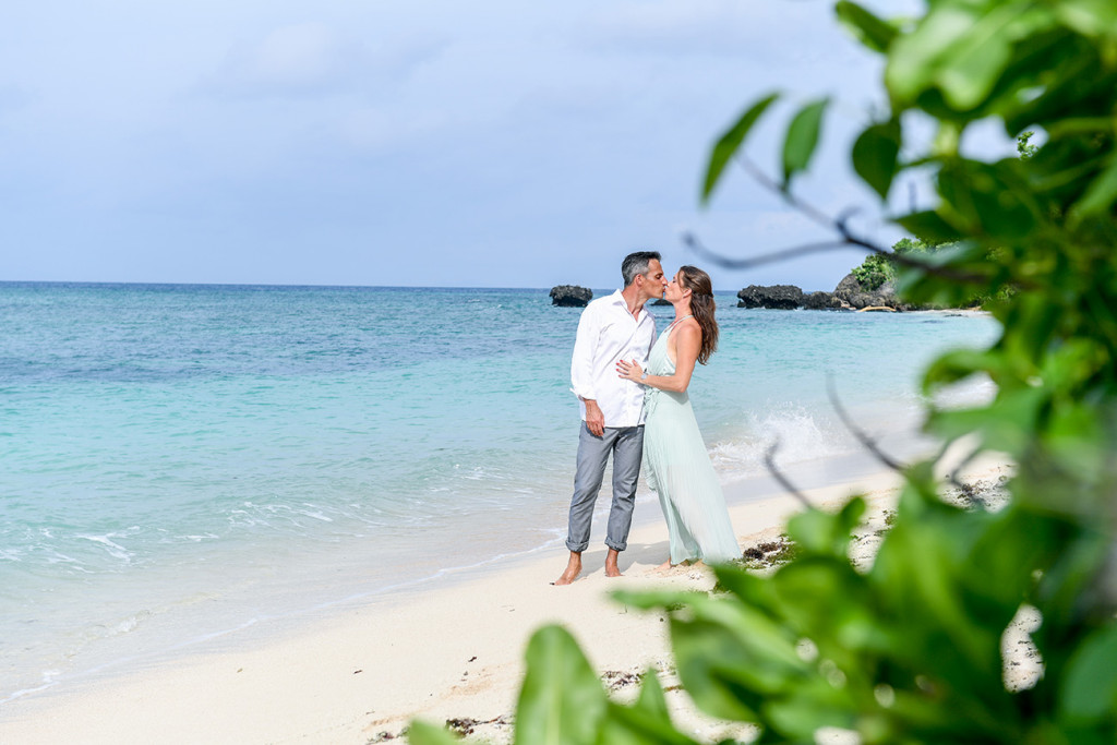 Couple kissing on the beach at Vomo Island resort, Fiji