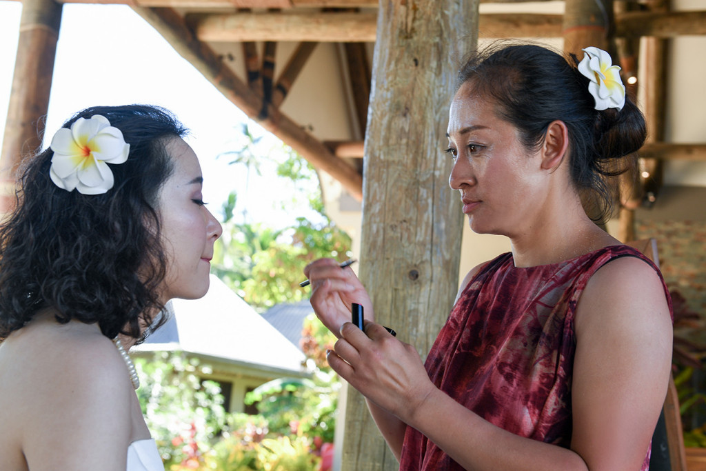 The bride is having a make up adjustment Paradise Cove island resort, Fiji