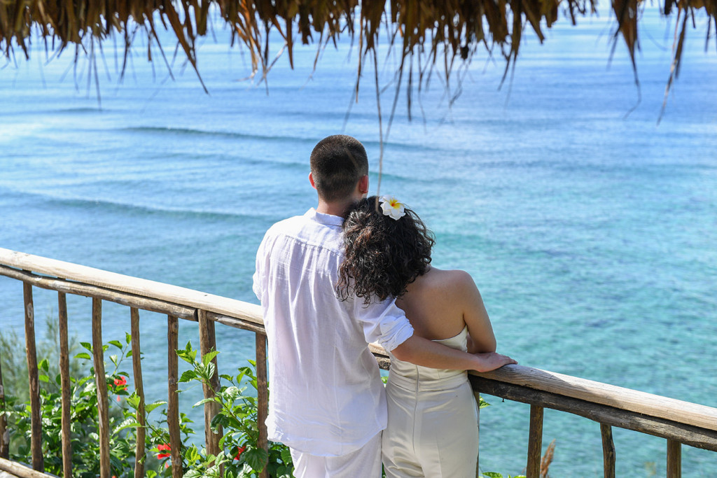 The couple at Sunset point with blue sea Paradise Cove island resort, Fiji