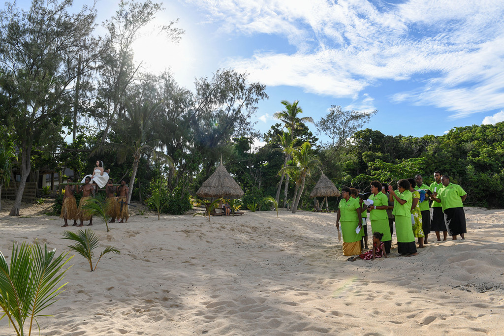 The Fijian traditional choir is singing while the bride is entering the ceremony at Paradise cove island resort, Yasawas, Fiji