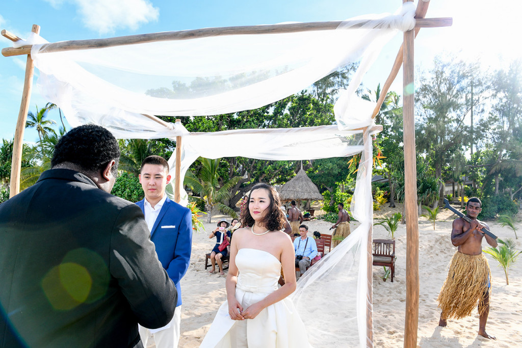 The celebrant is giving the wedding ceremony at Paradise cove island resort, Yasawas, Fiji