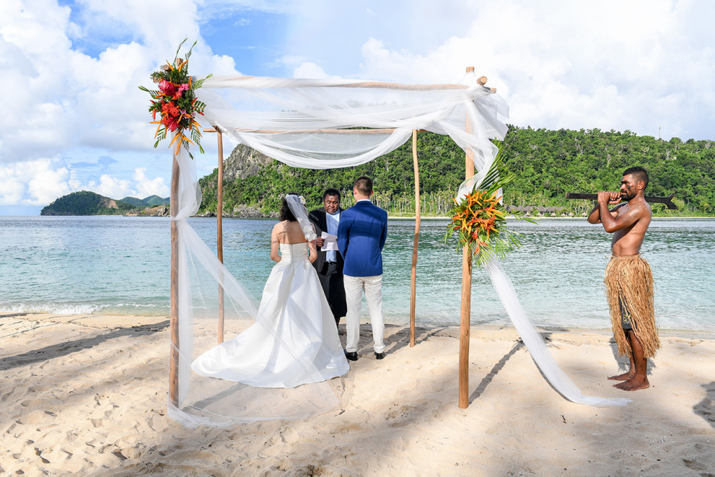 Four poles are used with flowers as an arch for the wedding ceremony at Paradise cove island resort, Yasawas, Fiji