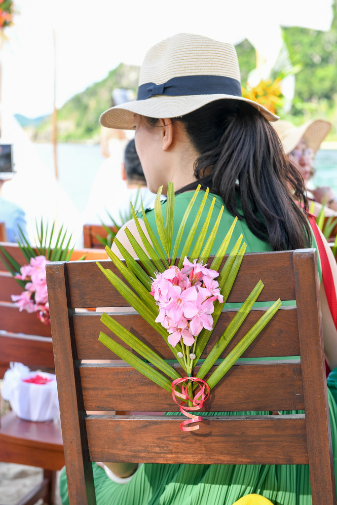 The chairs have fresh tropical flower for decoration at the wedding ceremony at Paradise cove island resort, Yasawas, Fiji