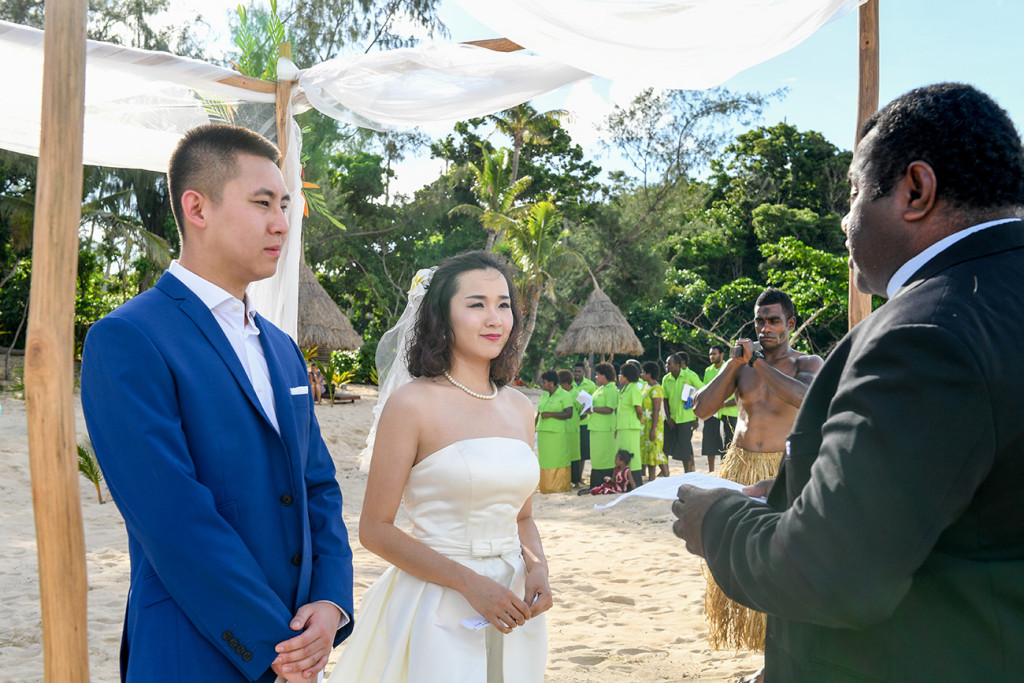 The couple say yes I do at the wedding ceremony by the beach at Paradise cove island resort, Yasawas, Fiji
