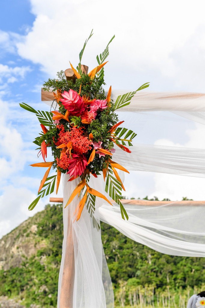 Tropical Fijian flowers are decorating the wooden structure at the wedding ceremony at Paradise cove island resort, Yasawas, Fiji