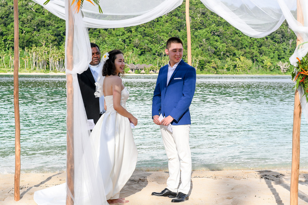 Bride and groom are waiting for their rings at Paradise cove island resort, Yasawas, Fiji