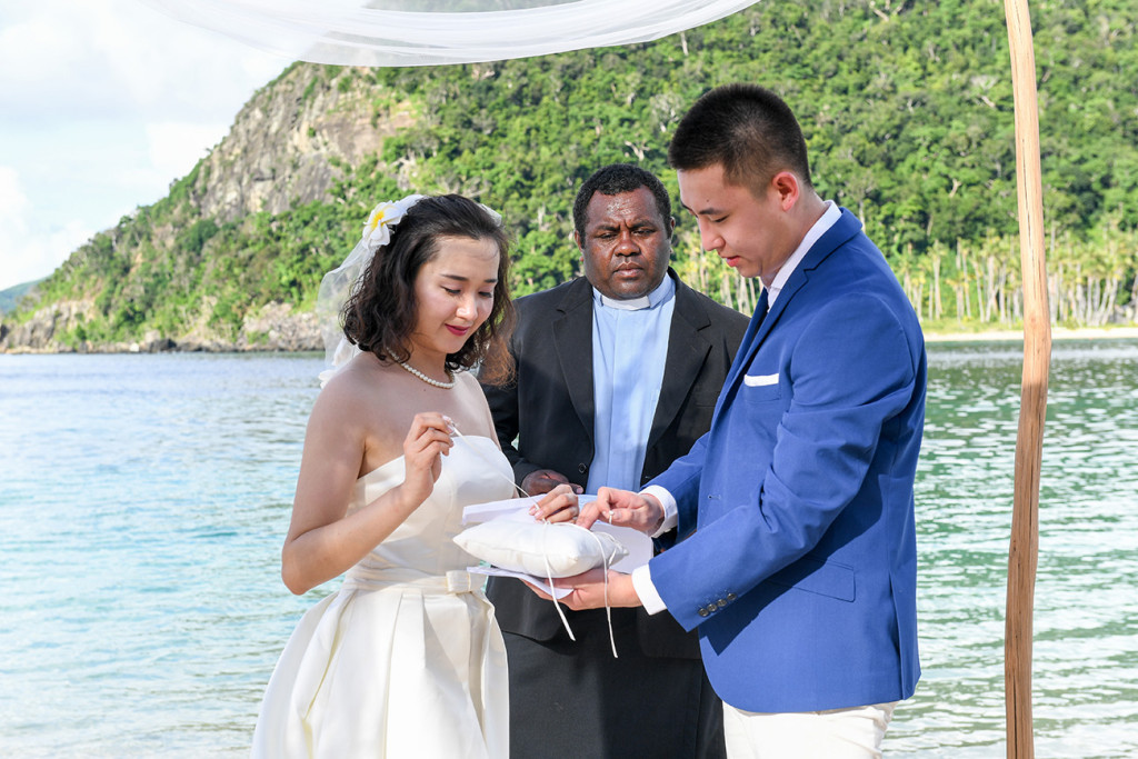 The bride is taking the ring on the illow at Paradise cove island resort, Yasawas, Fiji