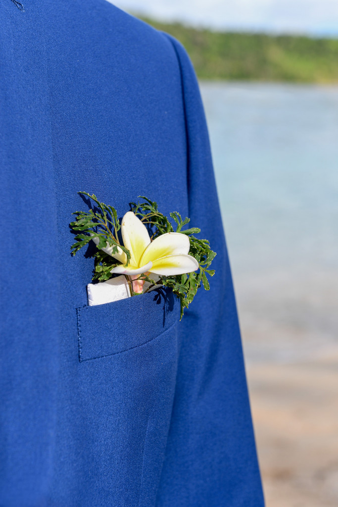 The groom's boutonniere made of greens and frangipane flower at Paradise cove island resort, Yasawas, Fiji