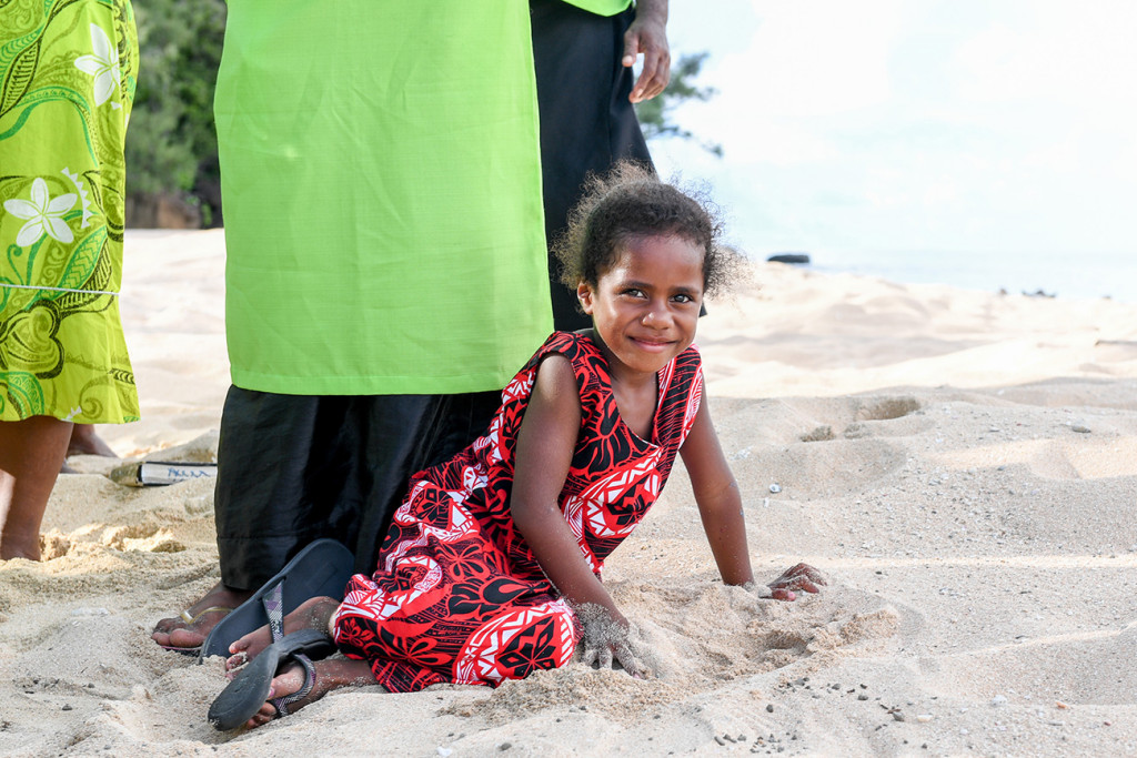 A young Fijian girl is sited by her mother at Paradise cove island resort, Yasawas, Fiji