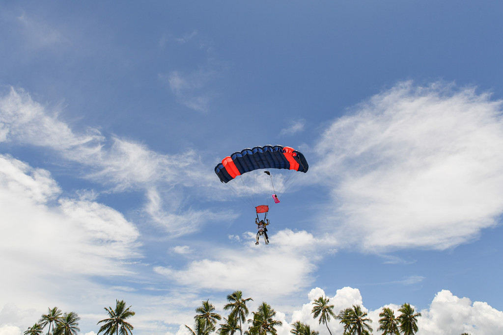 The bride and groom are parasailing by the sheraton beach in Denerau, Fiji