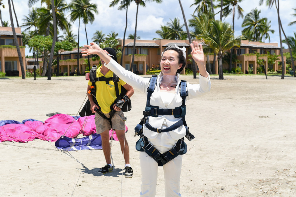 The bride is happy she has landed by the sheraton beach in Denerau, Fiji