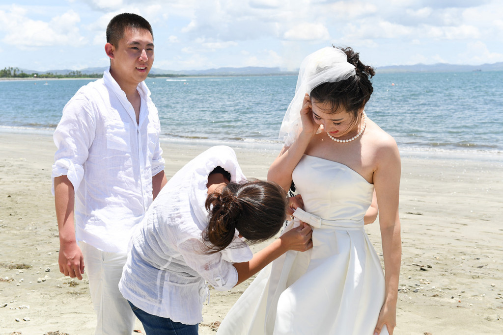 the bride is getting ready for photography by the sheraton beach in Denerau, Fiji