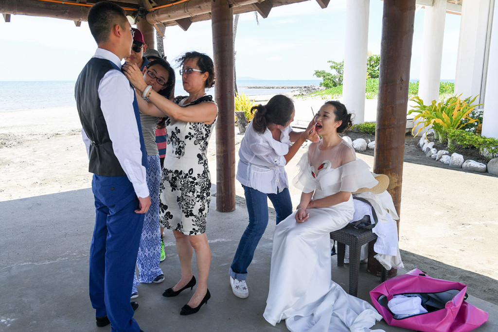 the groom is getting ready for his photography by the sheraton beach in Denerau, Fiji