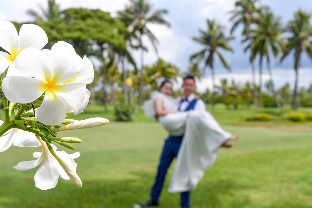 The groom is carrying the bride at the golf course in Denerau, Nadi Fiji.