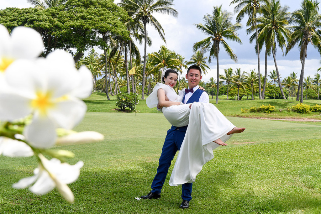 The groom is carrying his wife at the golf course in Denerau, Nadi Fiji.