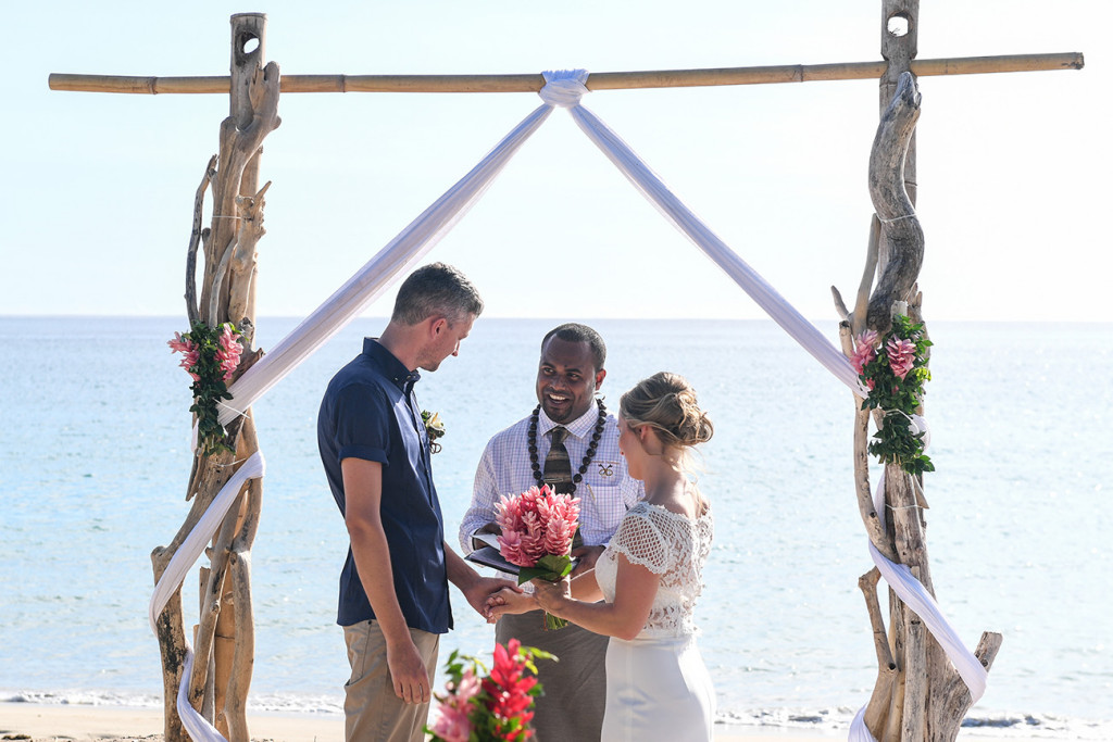 Bride and groom at the altar in Yatule Fiji elopement