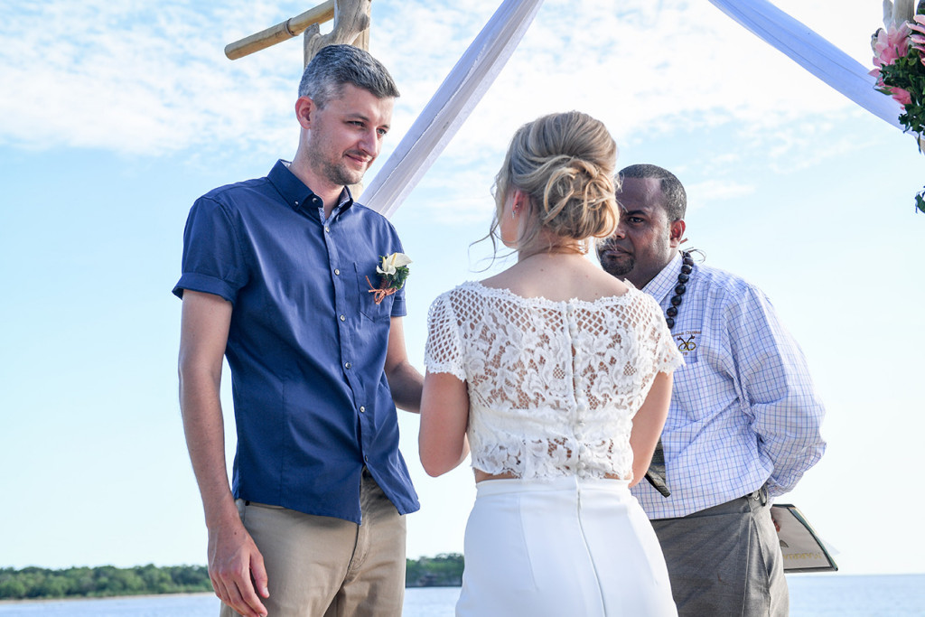 Vow exchange in Fiji elopement beach wedding ceremony