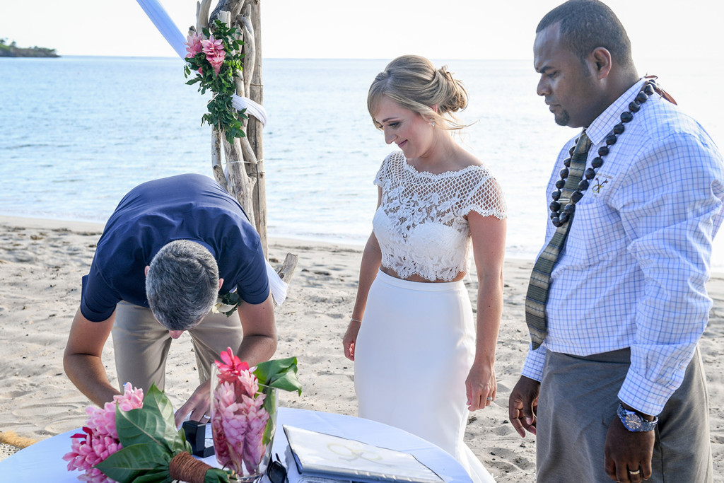 Signing of marriage certificate in Yatule Fiji elopement beach wedding