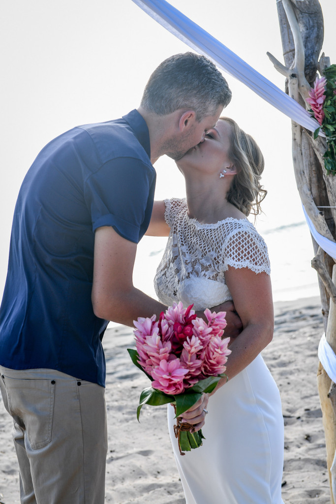Bride and groom kiss on Yatule Fiji beach wedding